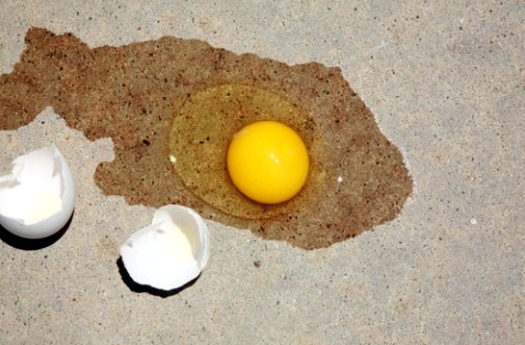 Frying egg on the sidewalk hot