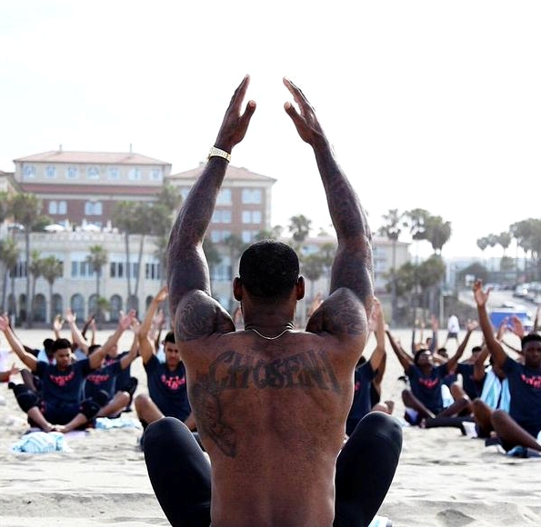 LeBron James leads yoga at Nike basketball Academy inn June. | photo credit: @sheilamikailli