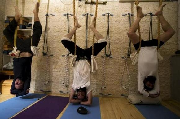 Ultra-Orthodox Jewish men take part in a yoga class at a studio near Jerusalem