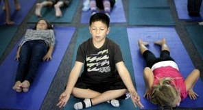 Dec. 11, 2012: Fourth grader Miguel Ruvalcaba holds a pose during a yoga class at Capri Elementary School in Encinitas, Calif. (AP/Gregory Bull)